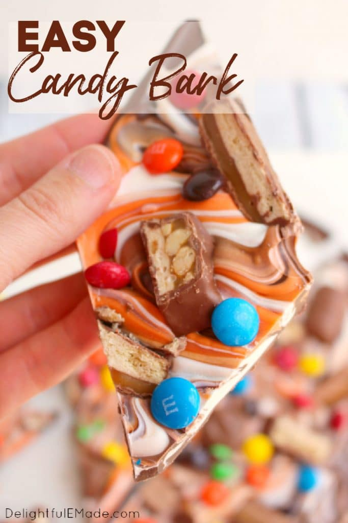 Halloween candy bark, close of photo of the candy bark being held.
