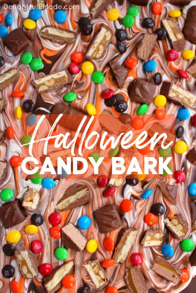 Chocolate, white chocolate and orange chocolate melts swirled together and topped with M&M's, snickers, twix and 3 Musketeers candy bars.