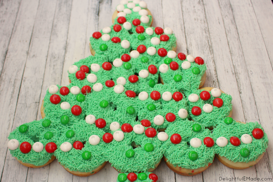 These Christmas Tree Donuts are a fun, morning treat perfect for the holidays! Adorned with Milk Chocolate and White Peppermint M&M's® , these festive baked cake donuts are fun to decorate with everyone in the family. The perfect treat to enjoy with hot chocolate!