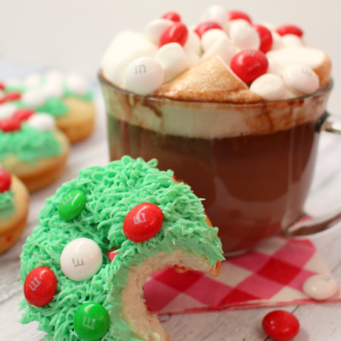 These Christmas Tree Donuts are a fun, morning treat perfect for the holidays! Adorned with milk chocolate and white peppermint MM's, these festive baked cake donuts are fun to decorate with everyone in the family. The perfect treat to enjoy with hot chocolate!