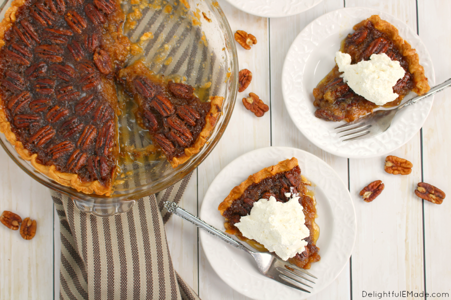 Classic flavors in the ultimate holiday dessert! This Classic Pecan Pie is perfect for any holiday dinner, party or get-together, and when topped with a delicious Vanilla Bean Whipped Cream, this dessert will make your holiday complete!