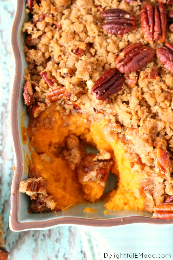 Ruth's Chris restaurants are famous for this amazing Sweet Potato Casserole - now you can make it at home! Creamy, delicious sweet potatoes are topped with a crisp, pecan streusel topping making for an amazing side to any holiday meal! An amazing Thanksgiving or Christmas dinner side dish!