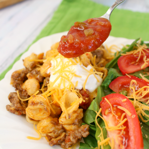 Need an easy, delicious dinner idea that everyone in the family will love? This easy Taco Bake is mac and cheese and tacos combined into one cheesy, delicious dinner! Perfect for Taco Tuesday or any other day of the week!