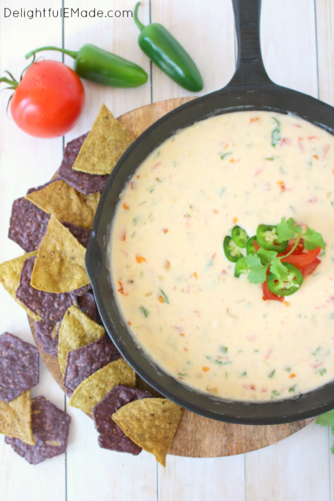 This hot, cheesy dip is perfect for game day! Loaded with two types of cheese, along with fresh tomatoes, jalapenos, and onions, this restaurant-style queso is the perfect appetizer anytime you want a great snack!
