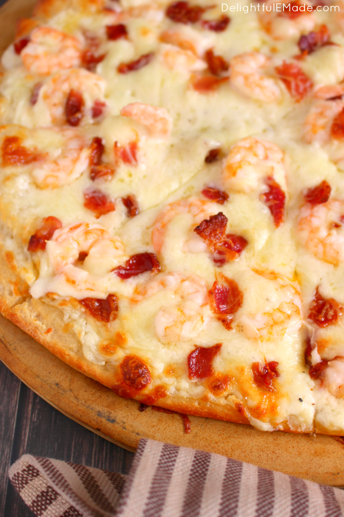 The ultimate pizza for Alfredo lovers! Loaded with tender shrimp, crisp bacon and lots of cheese, this pizza is the perfect way to enjoy all your favorite flavors on one delicious slice!