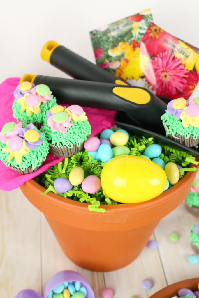 These fun, colorful cupcakes are the perfect mix of pretty pastel flowers, and delicious chocolate cake! Decorated with green grass frosting and topped with spring pansies adored with milk chocolate M&M's® Pastel candies, these cupcakes are perfect for Easter or any fun, spring occasion!
