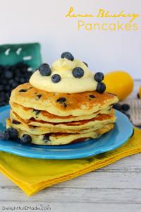 The fresh, delicious flavors of lemon and blueberry come together in these fluffy Lemon Blueberry Pancakes. Topped with a delicious lemon cream cheese whipped topping, and fresh blueberries, these make for an amazing breakfast or brunch!