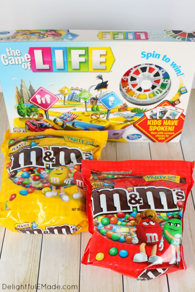 If you're a chocolate and peanut butter lover, these brownies are for you! Rich, fudgy brownies are layered with peanut butter filling, a chocolate peanut butter ganache and topped with Peanut Butter M&M's® candies! The perfect treat for family game night, or anytime you're in the mood for a chocolate and peanut butter treat!