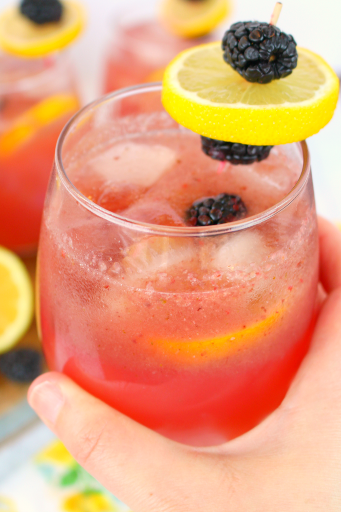 Fresh, sweet lemonade made with delicious blackberries for the most wonderful cold, refreshing drink! The perfect beverage to cool off on a warm spring or summer day and a fantastic drink for parties, showers, and get-togethers as well!