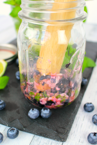 This Blueberry Coconut Mojito is an amazing cocktail perfect for sipping on a hot day! Coconut rum along with muddled blueberries, mint leaves and coconut come together wonderfully to make this refreshing, delicious drink. A great beverage to celebrate Cinco de Mayo, too!