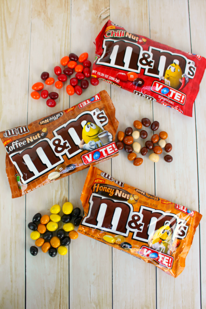 An amazing no-bake snack bar loaded with the new M&M's® Honey Nut candies, chocolate chips, honey and peanut butter! Super simple to make, these easy bars come together in minutes making the perfect on-the-go snack!