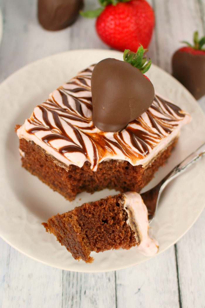 Chocolate and strawberries has never been more delightful! Moist, delicious chocolate cake topped with an amazing strawberry whipped topping and hot fudge swirl! If you like chocolate covered strawberries, you're gonna LOVE this cake!