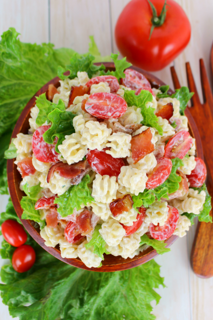 The perfect side dish for any potluck, cookout, picnic or back yard BBQ!  This Creamy Ranch BLT Pasta Salad is loaded with bacon, tomatoes, crisp green leaf lettuce, and topped with an amazing creamy ranch dressing!  Make extra - this disappears FAST!!