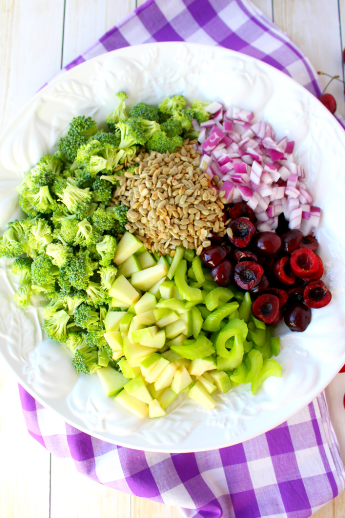 This Healthy & Easy Broccoli Salad recipe is a fantastic side dish, loaded with amazing flavor and crunch!  Fresh cherries, apples and a simple Greek yogurt dressing make this the best broccoli salad recipe that can be enjoyed any time of year!