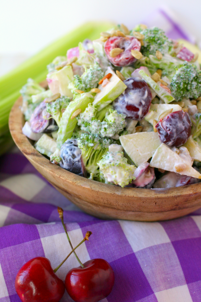 This fantastic Broccoli Salad is the perfect side dish, loaded with amazing flavor and crunch!  Fresh cherries, apples, celery, red onion, and sunflower seeds, along with the broccoli and a simple creamy dressing make this a great summer salad that can be enjoyed any time of year!