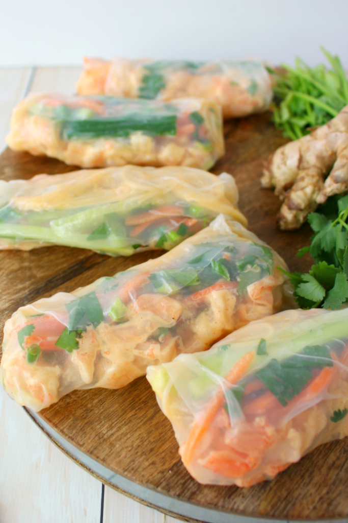 Fresh veggies, tender shrimp and rice noodles are all wrapped together in a spring roll wrapper for the most amazingly flavorful Asian inspired roll.  These Shrimp Summer Rolls are the perfect healthy lunch option or great as a light dinner!