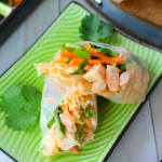 Fresh veggies, tender shrimp and rice noodles are all wrapped together in a spring roll wrapper for the most amazingly flavorful Asian inspired roll. Perfect for a tasty, delicious lunch or light dinner!