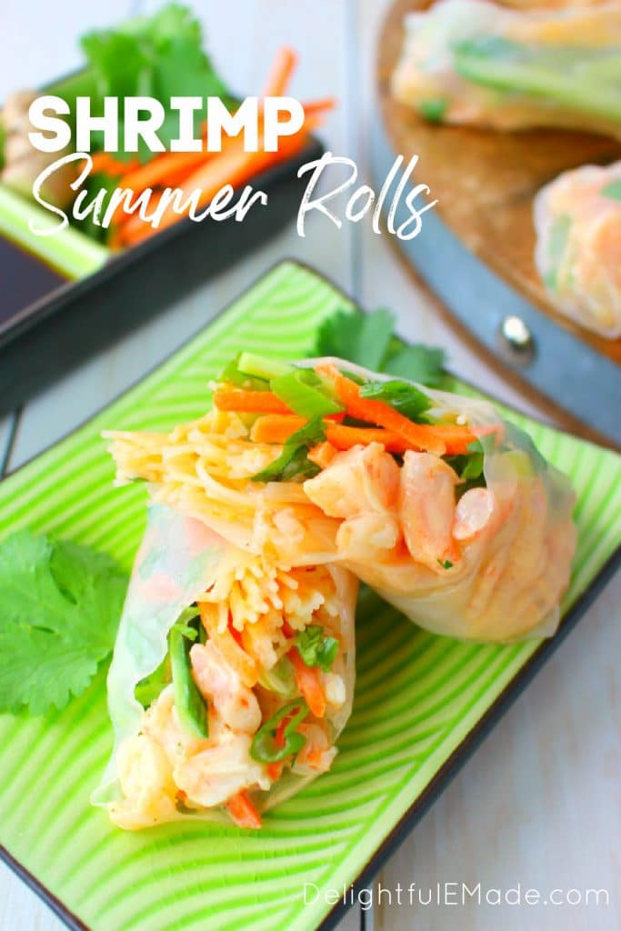 Homemade shrimp summer rolls, sliced in half on plate.