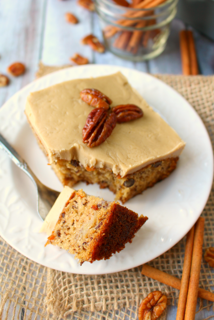 A classic banana cake brought to a whole new level!  Moist, sweet cake baked with pecans and topped with a delicious maple frosting, and brown sugar glazed pecans, this cake is perfect for any and every occasion!