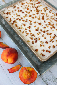 If you love fresh, summer peaches this dessert is for you! My Peaches & Cream Dessert Bars have a Pecan Sandie cookie crust, cream cheese filling, fresh peaches and toasted pecans! You don't have to be a Southerner to enjoy this fabulous dessert!