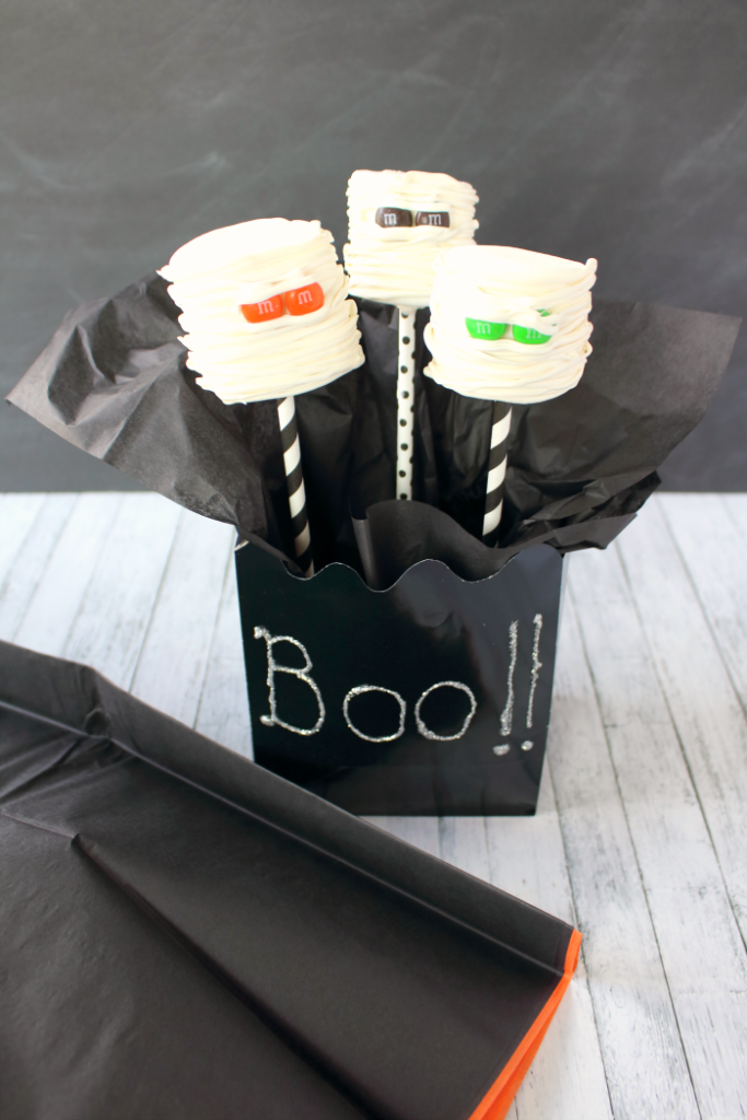 Let the Halloween BOO'ing begin! Have some friends, family, or neighbors that you would love to share some Halloween spirit with? Make them these fun Marshmallow Mummy Pops and share them in these fun and simple Halloween BOO Bags complete with lots of MARS® and Wrigley® Fun Size Candy and a card letting them know they've been BOO'd! You'll start a fun fall tradition that will get everyone into the spirit of the season!