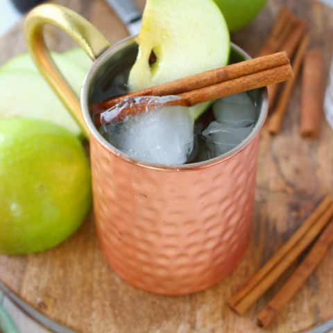 The perfect apple cocktail to enjoy on a crisp autumn day! My Apple Ginger Moscow Mule is made with spiced apple cider, Ginger liqueur, Ginger beer, and topped with a fresh, crisp Granny Smith Apple slice! How 'bout them apples?!