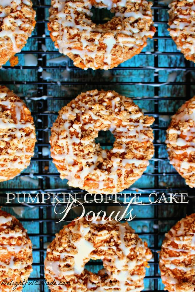 Need an excuse to do some fall baking? My Pumpkin Coffee Cake Donuts are the perfect recipe to indulge your pumpkin spice cravings! Baked, not fried, these pumpkin cake donuts are topped with a cinnamon streusel and lightly glazed for the ultimate breakfast treat!