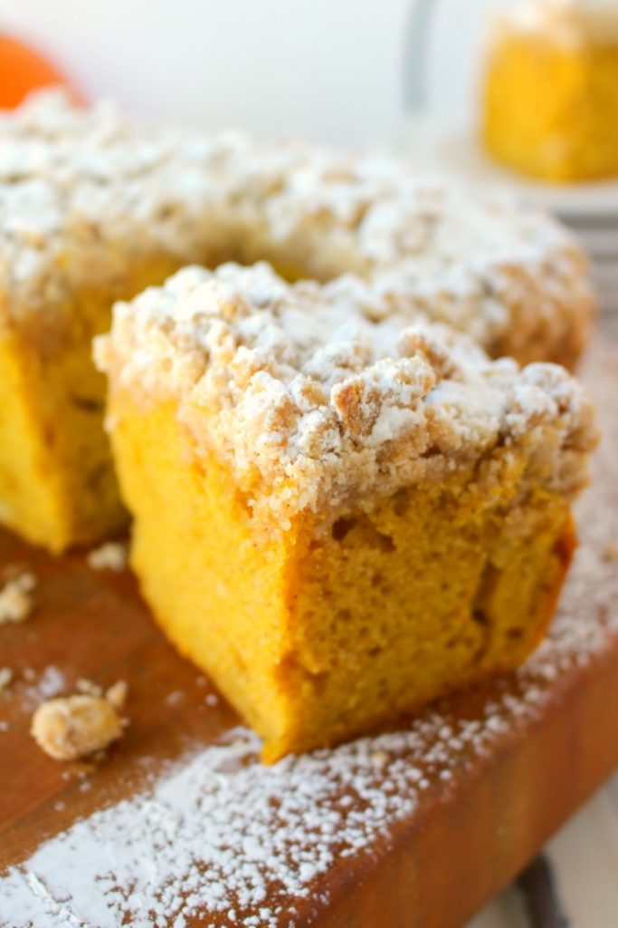 Meet your new favorite crumb cake recipe!  This incredibly moist, velvety pumpkin crumb cake has all your favorite fall flavors topped with an amazing cinnamon crumble.  It's the perfect pumpkin coffee cake to serve on Thanksgiving morning, or simply enjoy with your pumpkin spice latte!