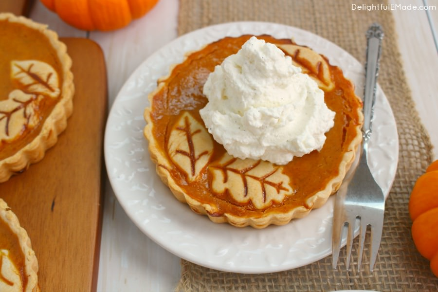 The perfect Thanksgiving or Christmas dessert!  These easy tarts are just like pumpkin pie, but when made in small tart pans, they become the most beautiful individual dessert for your holiday meal!  Topped with delicious vanilla bean whipped cream, your guests will be dazzled!