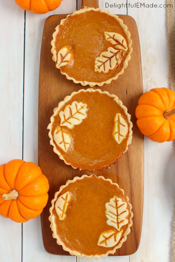 These easy Pumpkin Pie Tarts are just like classic pumpkin pie, but when made in small tart pans, they become the most beautiful individual dessert for your holiday meal!  Topped with delicious vanilla bean whipped cream, your guests will be dazzled!