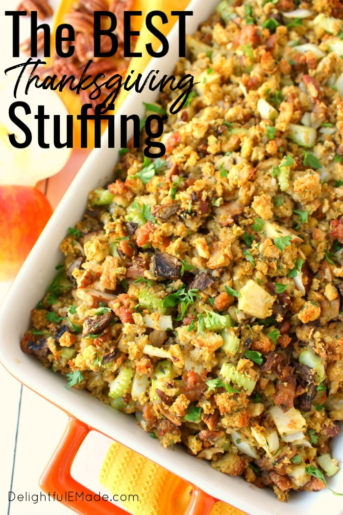 This Thanksgiving stuffing recipe will be an instant holiday dinner favorite with everyone at the table!  Loaded with apples, sausage, mushrooms, pecans and more, this easy stuffing recipe is the ultimate side dish for your holiday meal. Can be made in the oven or slow cooker!