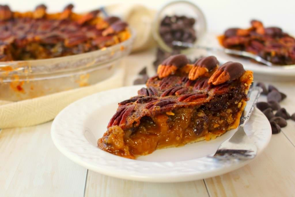Your favorite pie recipe made even more decadent and delicious! This Dark Chocolate Pecan Pie recipeis topped with chocolate covered pecans for a show-stopping dessert and isperfect for your Thanksgiving or Christmas dessert table!