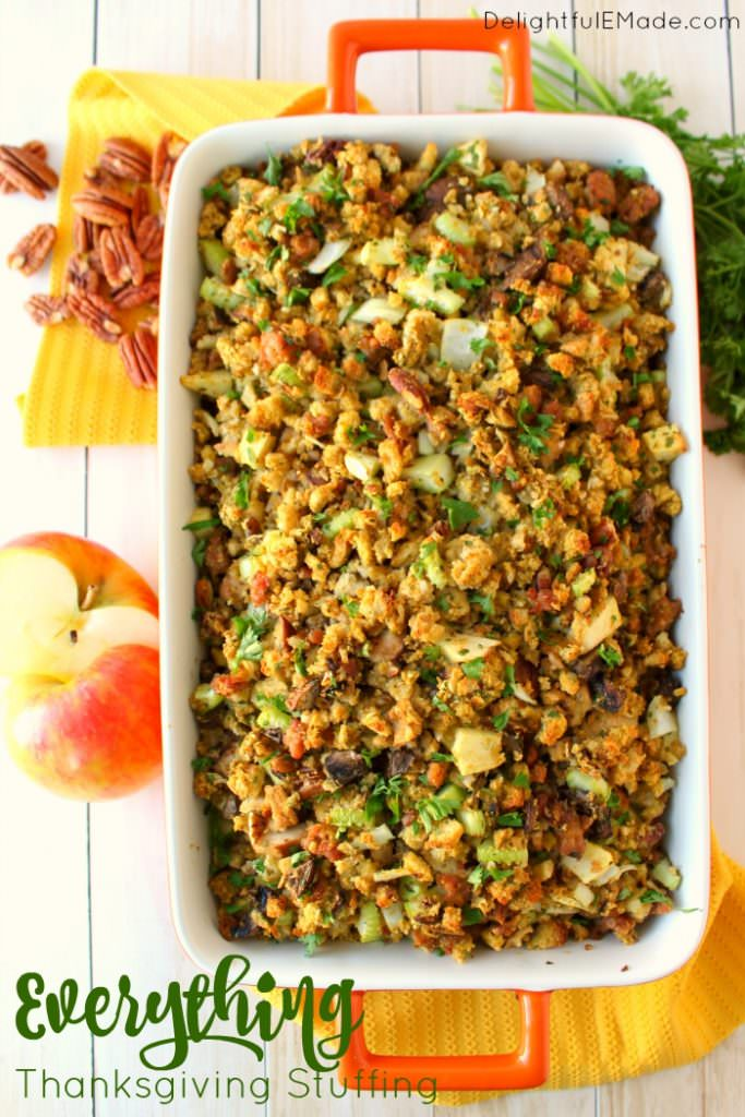 This Thanksgiving stuffing recipe will be an instant holiday dinner favorite with everyone at the table!  Loaded with apples, sausage, mushrooms, pecans and more, this dressing is the ultimate side dish for your holiday meal! Can be made in the oven or slow cooker!