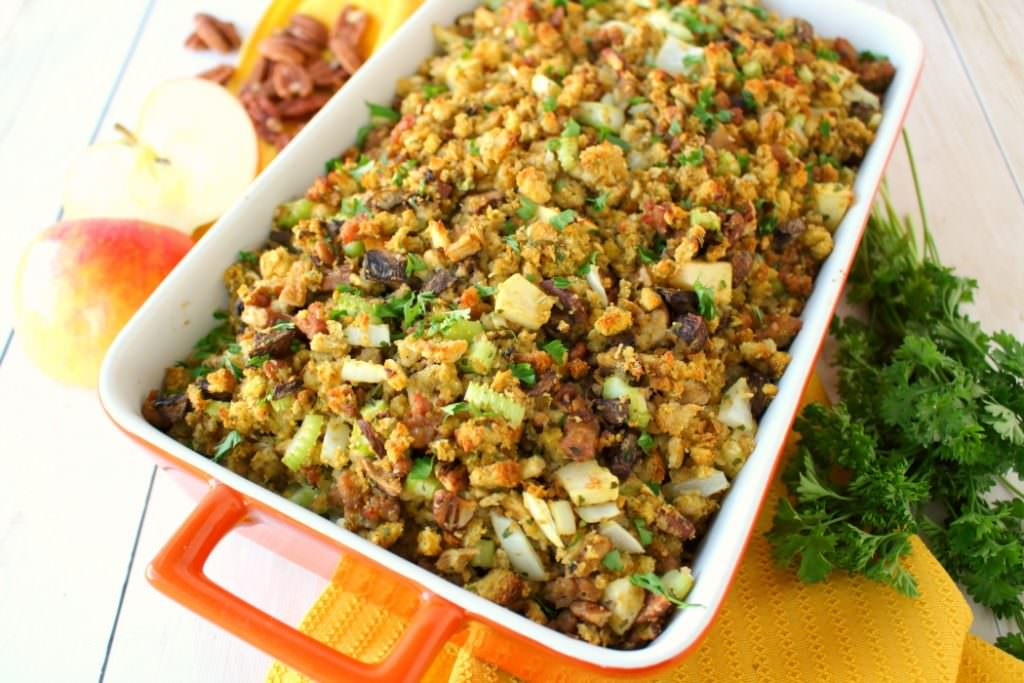 This Thanksgiving stuffing recipewill be an instant holidaydinner favorite with everyone at the table! Loaded with apples, sausage, mushrooms, pecans and more, this dressing is the ultimate side dish for your holiday meal! Can be made in the oven or slow cooker!
