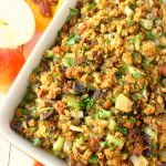 This stuffing recipe will be an instant Thanksgiving dinner favorite with everyone at the table! Loaded with apples, sausage, mushrooms, pecans and more, this dressing is the ultimate side dish for your holiday meal!