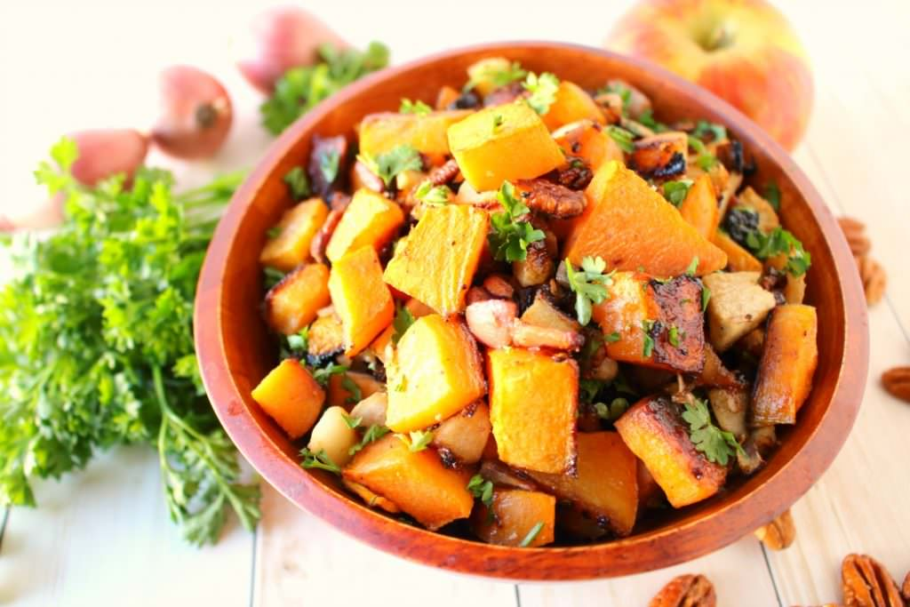 One of the most flavorful, delicious ways to prepare Roasted Butternut Squash!  Roasted with apples, bacon, pecans and shallots, this savory and slightly sweet side-dish is easy enough for a weeknight meal, and fancy enough to accompany your Thanksgiving or Christmas dinner!