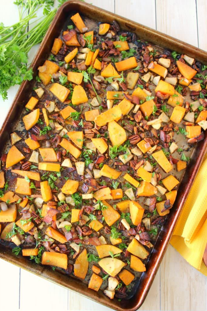 One of the most flavorful, delicious ways to prepare butternut squash! Roasted with apples, bacon, pecans and shallots, this savory and slightly sweet side-dish is easy enough for a weeknight meal, and fancy enough to accompany your Thanksgiving or Christmas dinner!