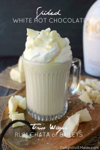 If you're a fan of Rum Chata or Bailey's, you're gonna LOVE this Spiked White Hot Chocolate! Homemade hot chocolate made with just a few simple ingredients, this hot cocktail is perfect for a chilly night in! Topped with whipped cream, white chocolate chunks and caramel this drink is decadent and delicious!