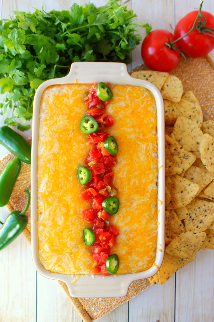 Jalapeno Popper Dip doesn't get much better than this! Made with Ro*Tel and Rosarita Refried Beans this hot cream cheese bean dip recipe is perfect for game day or anytime you want a delicious dip for snacking.