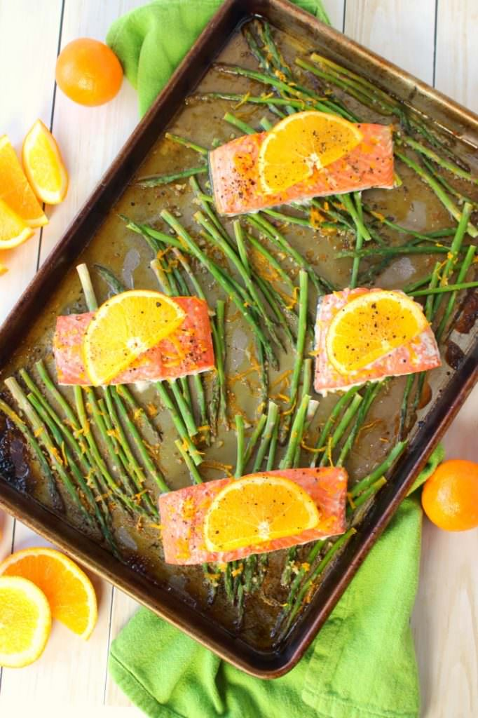 A wonderfully healthy, easy and delicious salmon recipe! Amazing flavors of oranges, lemon and lime glaze these salmon fillets, and when roasted with asparagus spears, it quickly becomes a super flavorful one pan meal. Healthy dinner ideas don't get much easier or delicious than this!