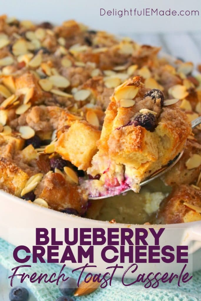 Blueberry French Toast casserole in a baking dish, with a spoonful being removed.