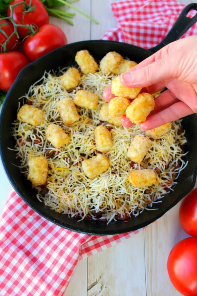 If you love the classic Tater Tot Casserole, this cheesy taco version is a must-make!  An easy dinner recipe, this one skillet meal is made with just six ingredients that you likely already have in your fridge and pantry.  Fantastic for Taco Tuesday, or anytime you're craving Tex-Mex!