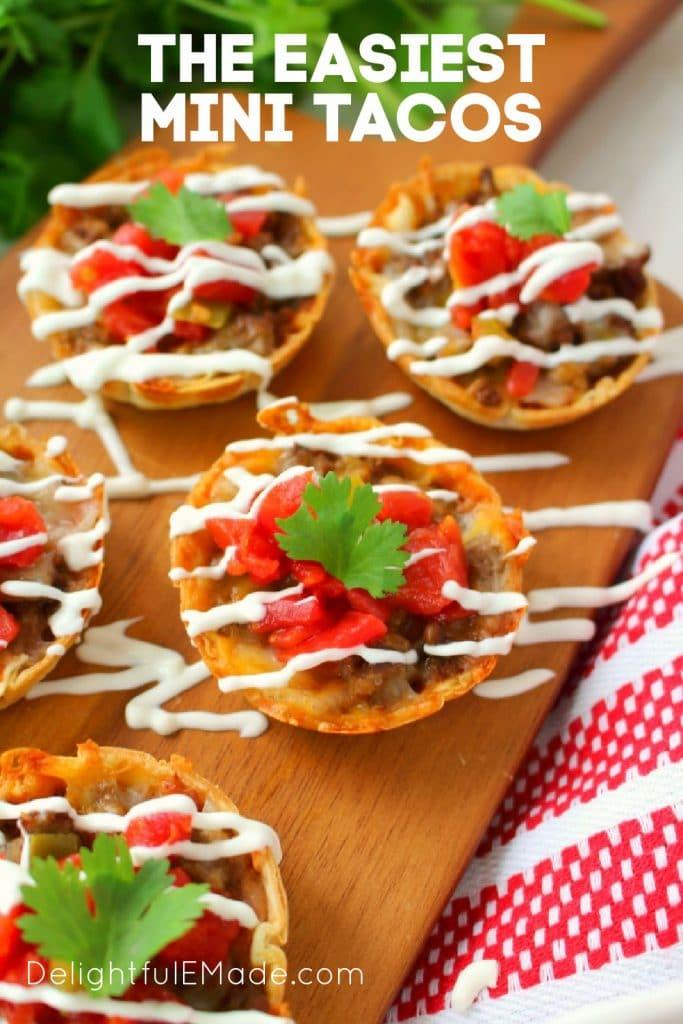 Mini tacos on board topped with sour cream. mini tacos recipe.
