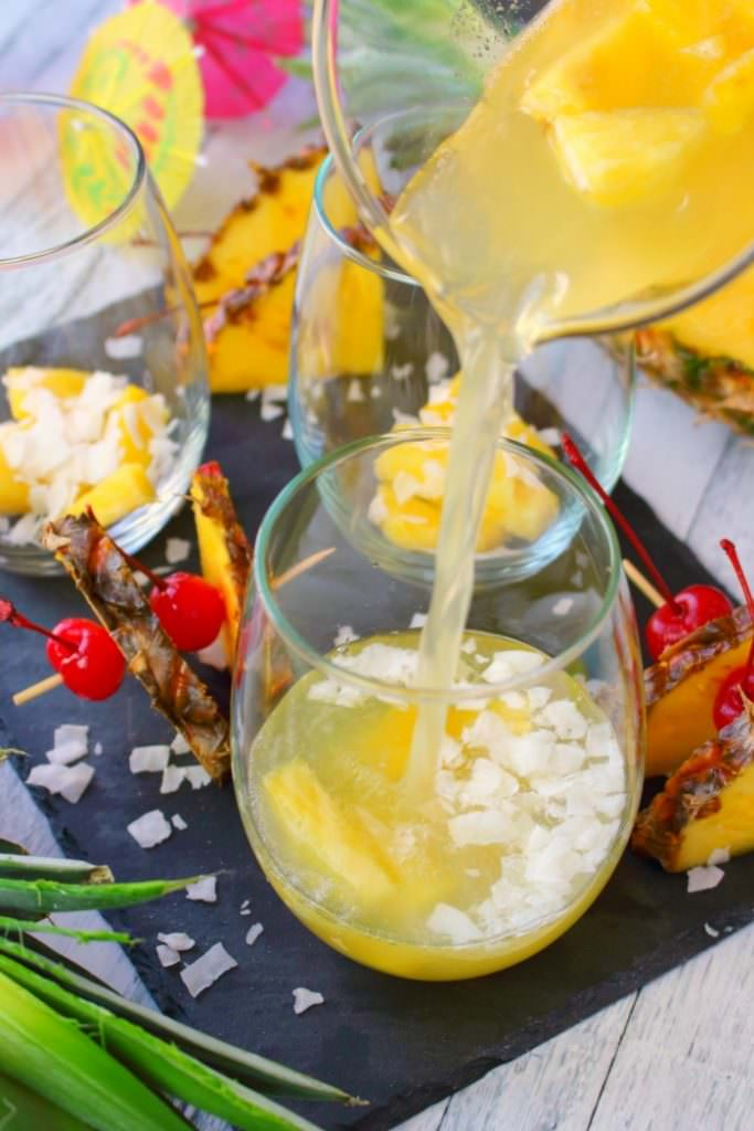 This Pina Colada recipe will be your new favorite happy hour drink!  Made with four simple ingredients, this fantastic champagne punch is perfect for parties, showers, and girls nights!  Forget the blender, this amazing pineapple coconut cocktail is super easy and completely delicious!