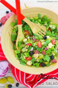 If you love Italian anitpasto, then this chopped salad recipe is right up your alley! Loaded with fresh romaine lettuce, mozzarella, olives, salami and more, this incredible anitpasto salad will quickly become a family favorite for every potluck, cookout, and picnic this summer!