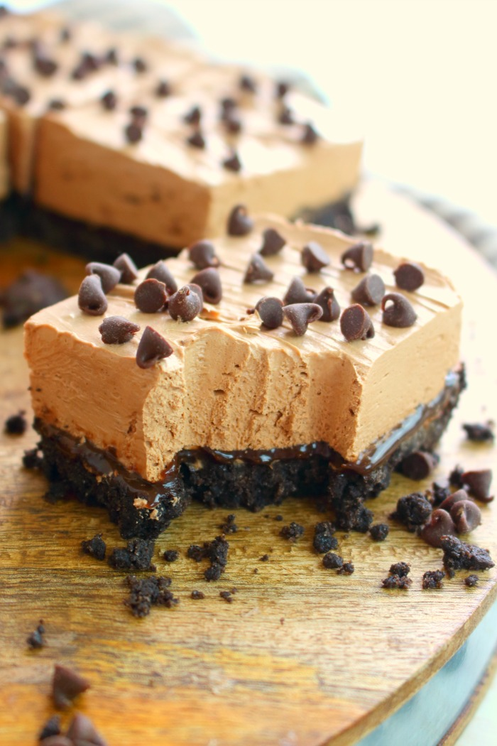 If you're looking for an easy, no bake cheesecake recipe, then these chocolate cheesecake bars need to be in your life! Made with layers of OREO's, hot fudge, and chocolate cheesecake, these cheesecake bars are every chocolate lovers dream!