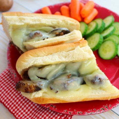 The ultimate slow cooker dinner idea for busy nights! Topped with mushrooms, provolone cheese, and served on Martin's Hoagie Rolls, these super-simple steak sandwiches are the perfect way to get dinner on the table when time is tight.