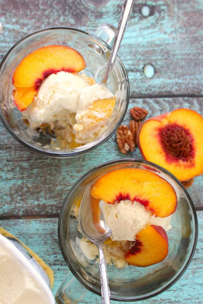 Just 4 ingredients is all you need to make this fantastic Cake Mix Peach Cobbler! Made in less time it takes to preheat the oven, this fantastic peach dessert is perfect anytime you're in the mood for old fashioned cobbler!