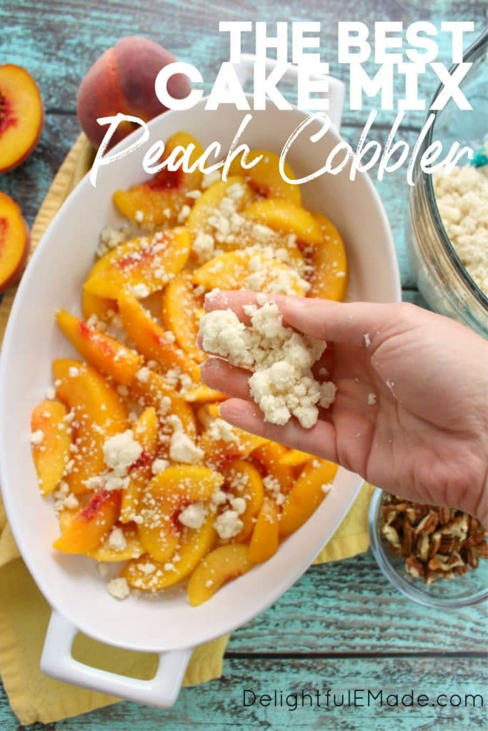 Cake mix peach cobbler, with yellow sliced peaches in a baking dish with cake mix crumble over the top of the peaches.