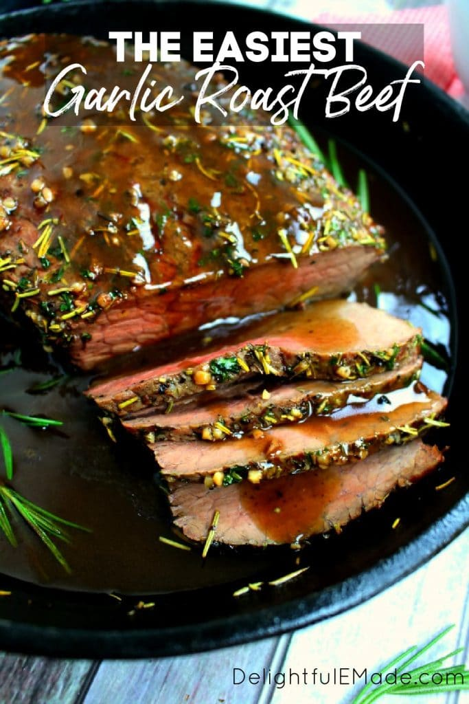 Sliced garlic roast beef topped with herbs and gravy